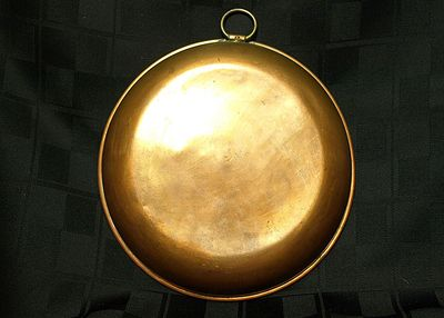 Copper pan with brass ring