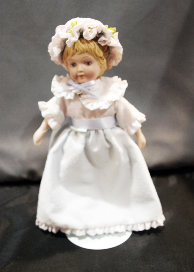 Avon Porcelain Doll